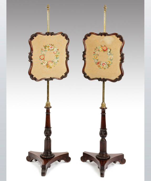 A pair of antique Regency pole screens.