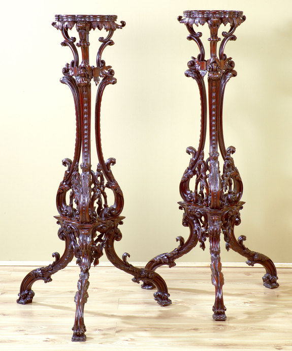 A superbly carved pair of Chippendale revival mahogany torcheres. Large Image 1