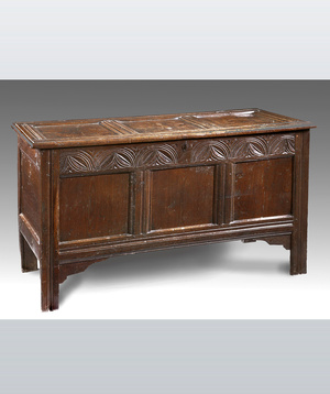 A 17th century oak coffer.