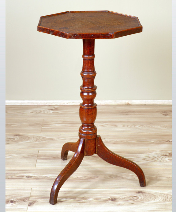An antique Regency oak tripod table.