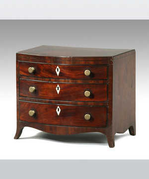 A miniature Sheraton period mahogany bowfronted chest.