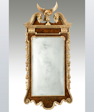 A fine George II period walnut and parcel gilt mirror of unusually large proportions.