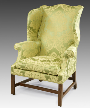 A good Chippendale period mahogany wing armchair.