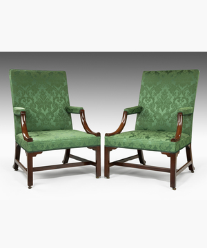 A pair of Chippendale Gainsborough armchairs.