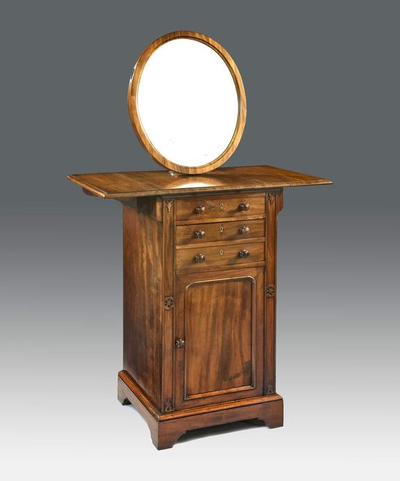 An unusual gentleman's Regency period mahogany dressing table. Large Image 1
