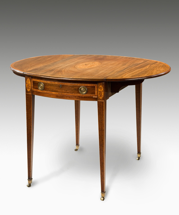 A Sheraton period mahogany oval pembroke table. Large Image 1