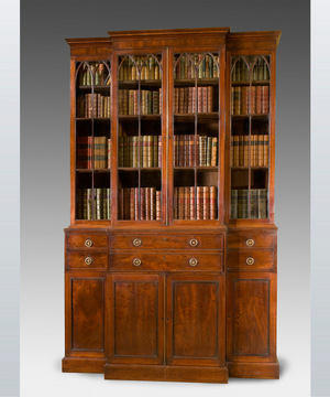 A fine George III period plumb pudding veneered breakfront bookcase.