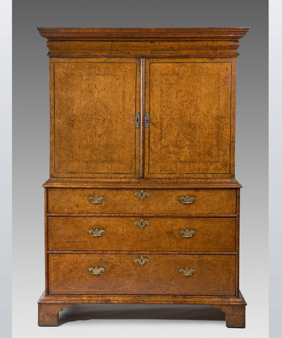 A rare Queen Anne period burr yew veneered cabinet on chest.