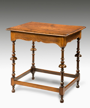 An unusual fruitwood and elm George II centre table.