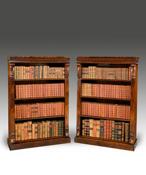 A fine pair of William IV period carved rosewood open bookcases.