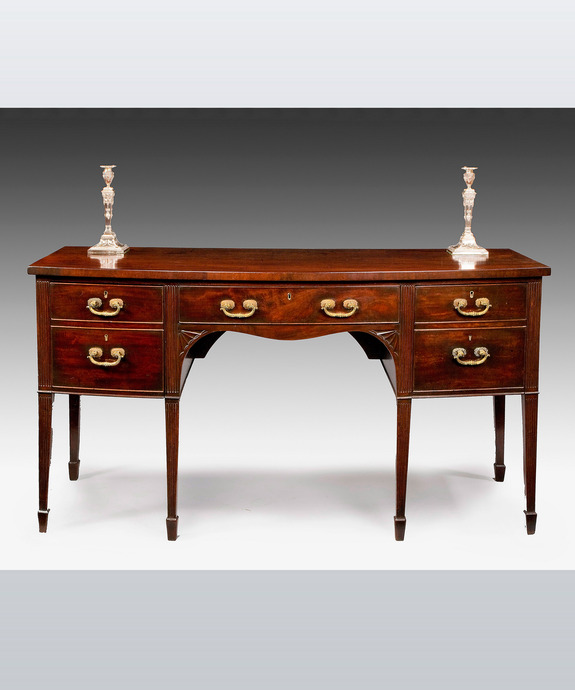 An antique Hepplewhite mahogany sideboard.
