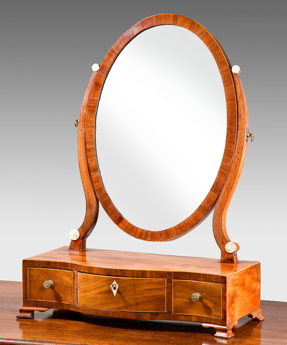 A Sheraton period mahogany serpentine fronted dressing table mirror. Large Image 1