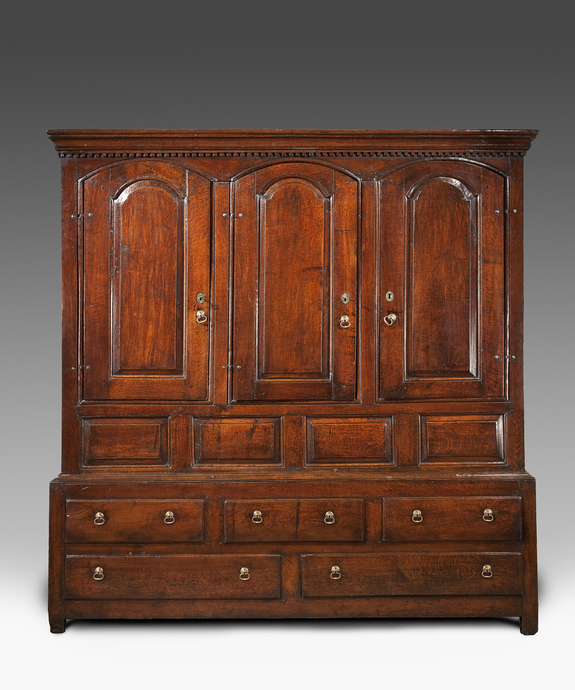 An early Eighteenth Century oak three door housekeeper's cupboard. Large Image 1