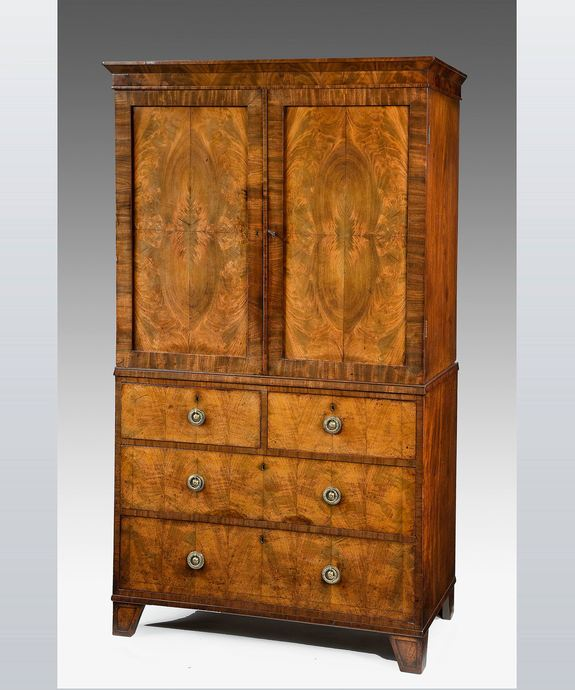 A beautifully patinated Regency period mahogany 2 door cabinet. Large Image 1