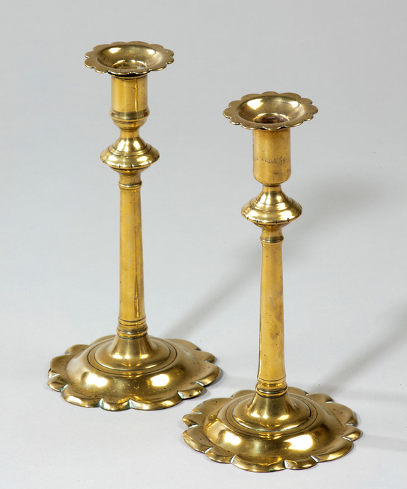 A pair of George II period brass candlesticks.