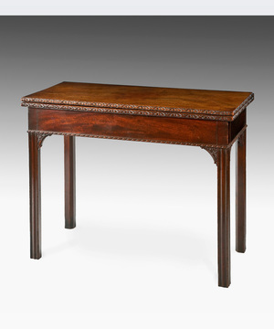 A well patinated Chippendale period mahogany tea table standing on square moulded legs.