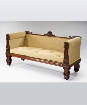 A crisply carved Regency period mahogany sofa.