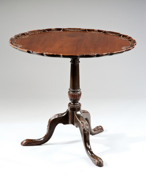 A fine 18th Century Irish carved mahogany tripod table.