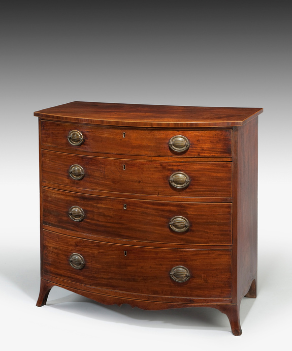 A Sheraton period faded mahogany bowfronted chest of drawers. Large Image 1