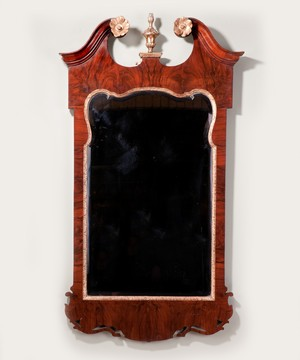 A George II walnut mirror.
