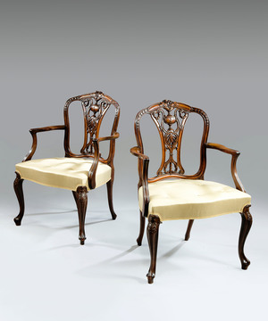 A pair of Sheraton revival armchairs.