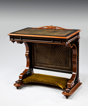 A rare late 19th Century ebony and snake wood writing desk.