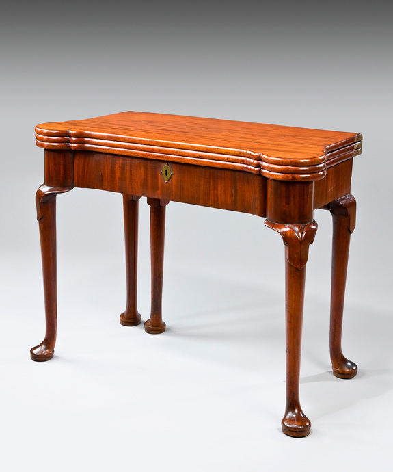 A George I period mahogany triple top games table. Large Image 1