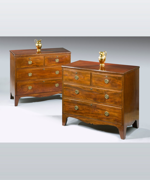 A pair of Regency period mahogany chests.