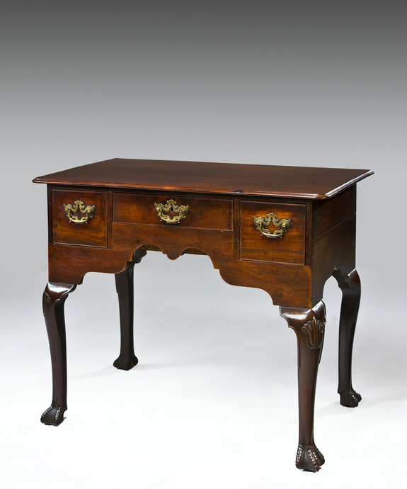 A George II period Irish mahogany lowboy. Large Image 1