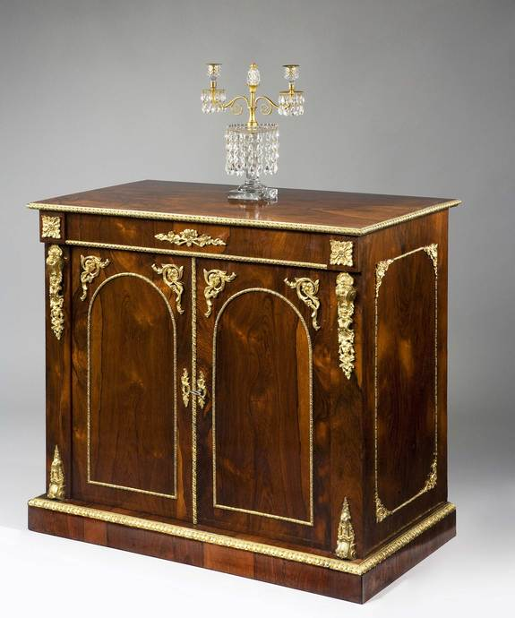 A fine early 19th Century rosewood veneered and ormolu mounted side cabinet. Large Image 1