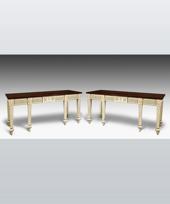 A pair of Adam revival console tables.