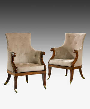 A fine pair of Regency period carved mahogany bergere armchairs.