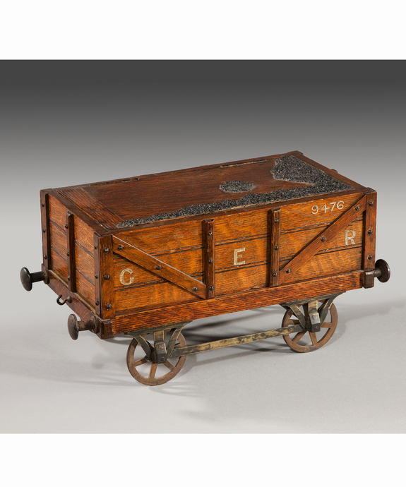 A fine 19th Century oak humidor in the form of a railway wagon.