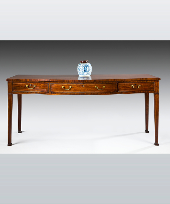 A fine Sheraton period mahogany serpentine fronted serving table. Large Image 1
