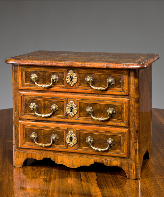 A miniature 19th Century commode.