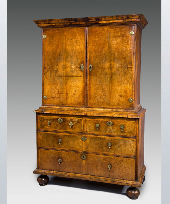 A well patinated Queen Anne period walnut veneered cabinet on chest. Large Image 1