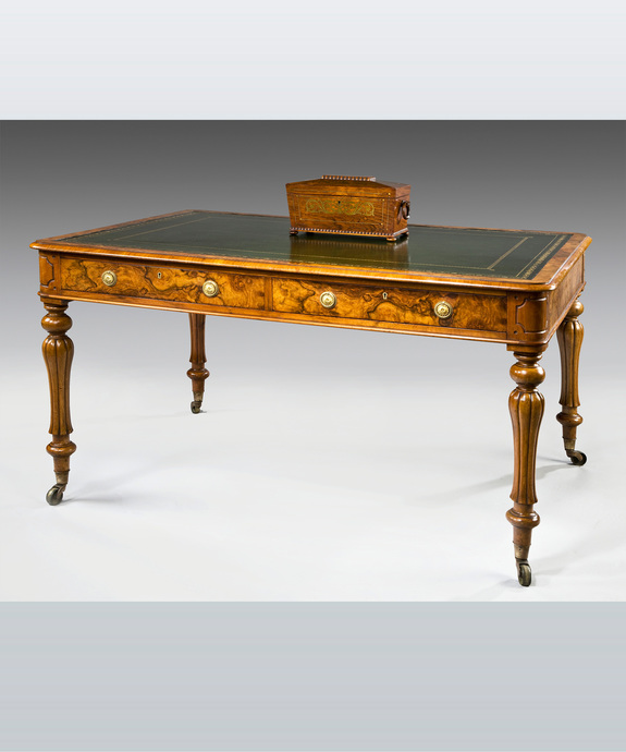 A fine mid 19th Century walnut veneered 4 drawer writing table. Large Image 1