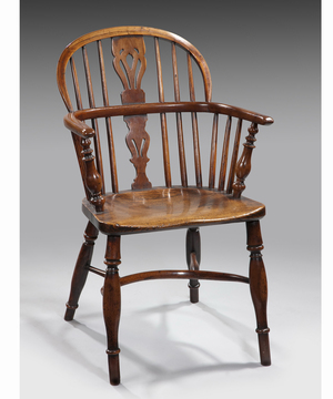 An 18th Century yew wood windsor armchair.