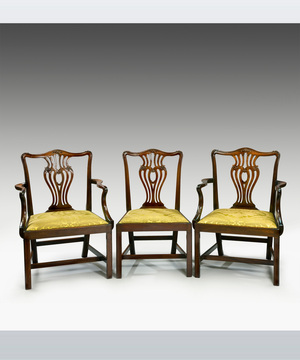 An elegant set of eight (6+2) Chippendale period mahogany dining chairs.