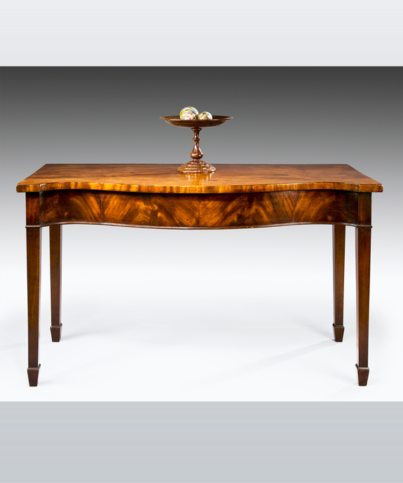 A Sheraton period mahogany serpentine fronted serving table. Large Image 1