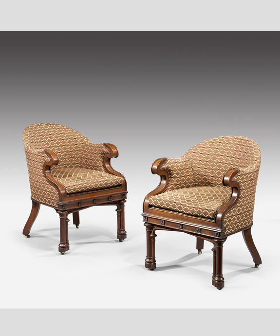 A pair of Gothic revival oak armchairs. Large Image 1