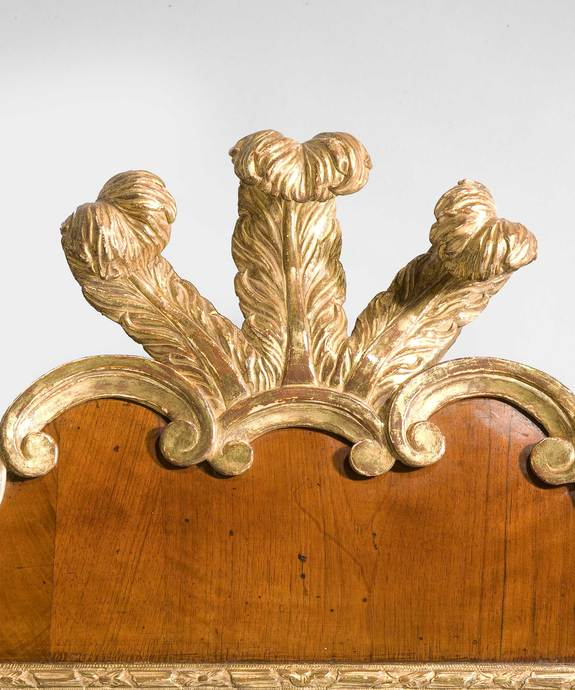 A George II period walnut and parcel gilt mirror. Large Image 1