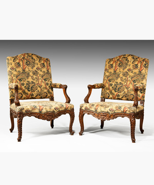 A pair of Louis XV revival carved walnut armchairs.