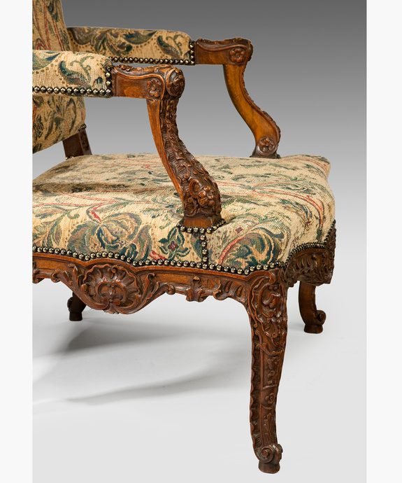 A pair of Louis XV revival carved walnut armchairs. Large Image 1