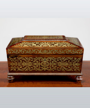 A Regency period rosewood veneered and brass inlaid jewellery box.