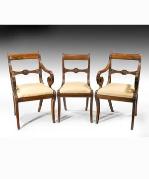 A  set of 14 (12+2) Regency mahogany dining chairs.