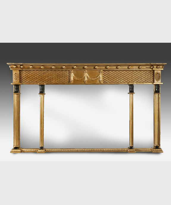 A Regency period carved giltwood overmantel mirror. Large Image 1