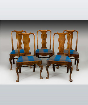 A well patinated set of five George II period mahogany dining chairs.