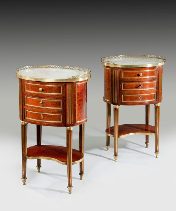 A fine pair of late French 19th Century mahogany oval commodes.