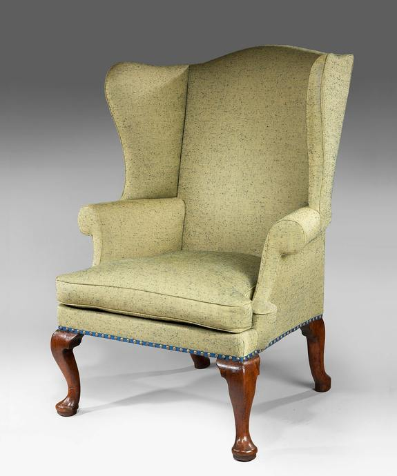 A George I period walnut wing armchair. Large Image 1